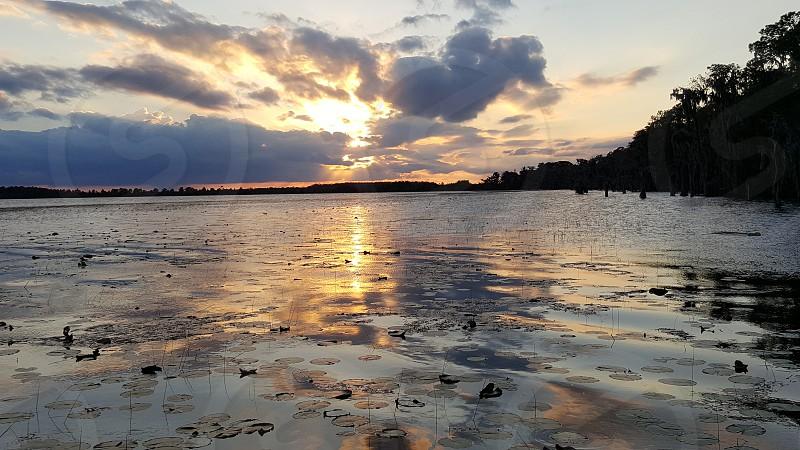 sunset beautiful sunsets lake water reflections photo