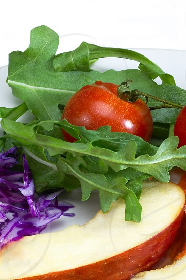 colorfull fresh salad ingredient on a plate prepared cutted photo