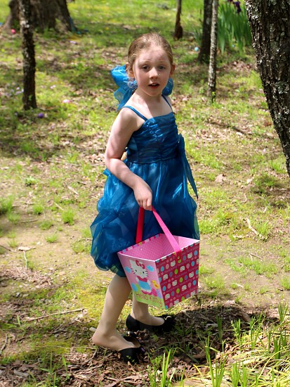 Girl in blue dress with Easter basket photo