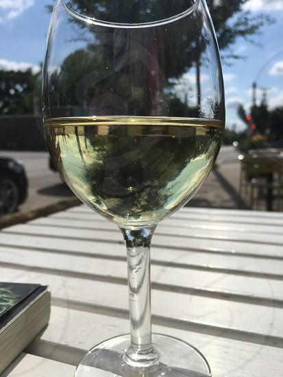 Wine reflection sunny summer sidewalk cafe outside cafe photo