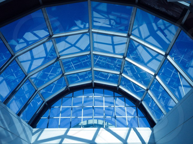 grey and black dome building glass ceiling photo