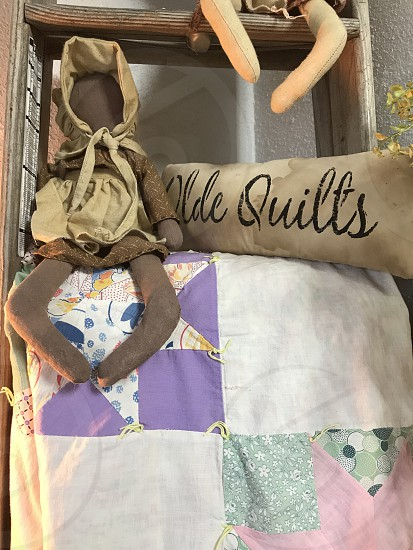 Vintage Doll & quilts. photo