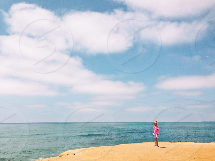 woman standing by the beach photo