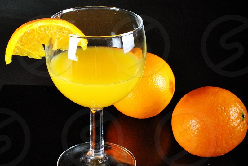 orange juice on wine glass photo