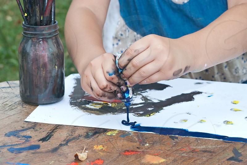 Child hands painting  photo