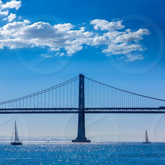 San Francisco Bay bridge sailboat from Pier 7 in California USA photo
