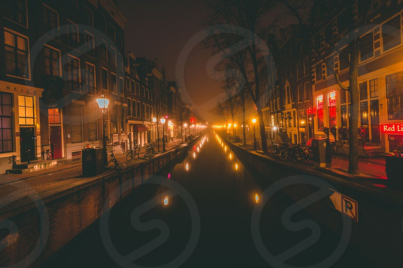 Brisk morning in Amsterdam's Red Light District. The empty streets are a stark difference from the crowds of people that normally roam the streets. photo