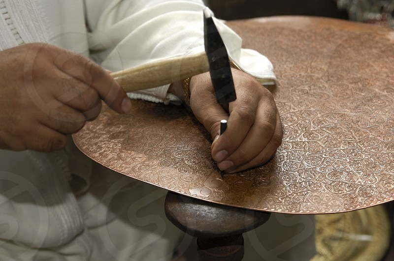 Coppersmith at work photo