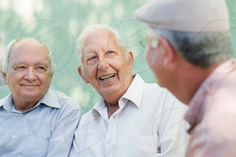 talking; hospice; bench; senior; seniors; men; friends; 60s; 70s; aged; buddies; caucasian; cheerful; elderly; emotions; enjoy; enjoyment; friendship; fun; glad; grandfather; green; happiness; happy; health; healthy; hispanic; latino; laughing; lifestyle; male; man; mates; natural; old; older; optimistic; park; people; persons; positive; relaxing; retired; retirement; satisfaction; sitting; smiling; three; wall; white photo