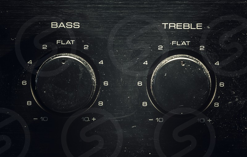 Two buttons closeup view bass and treble control.  photo