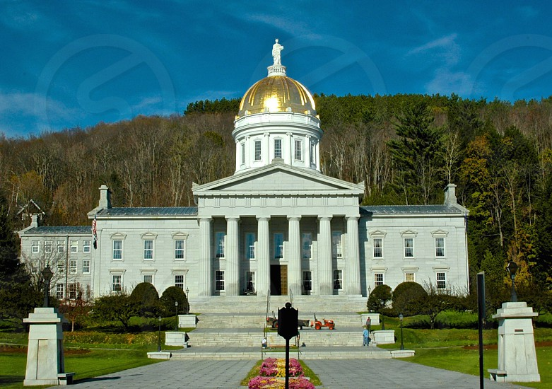 VT State Capital Building White and Gold Marble Stone Work Fall Blue Sky photo