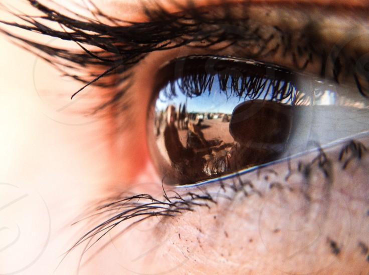 person's brown eye photo