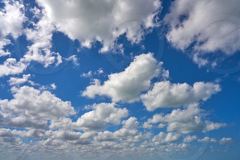 Blue summer sky white cumulus clouds background photo