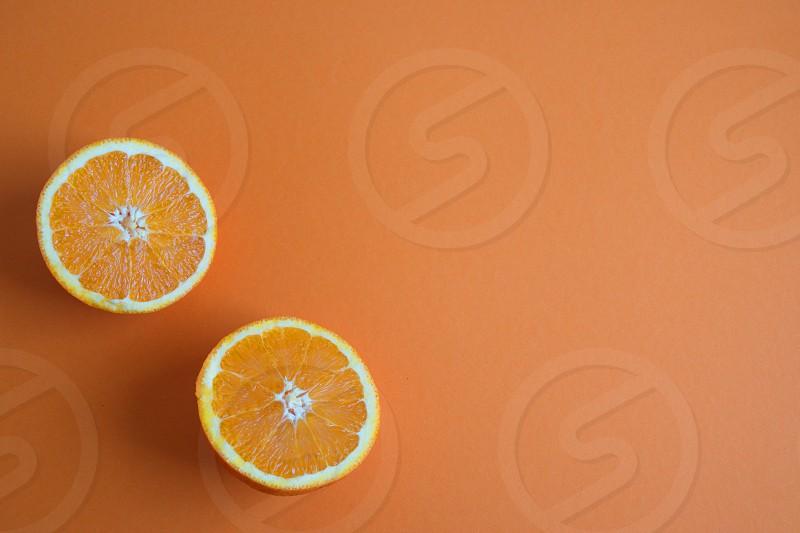 Directly above shot of the orange slices on the orange background photo