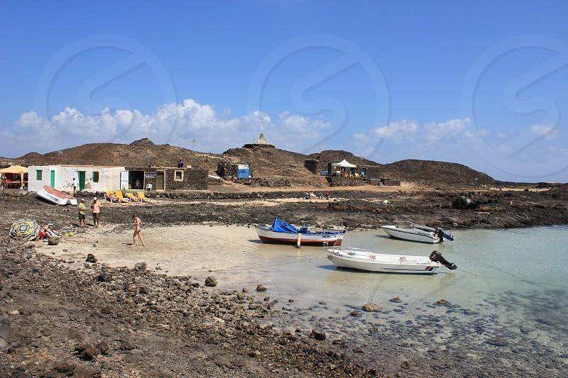 volcanic beach boats. photo