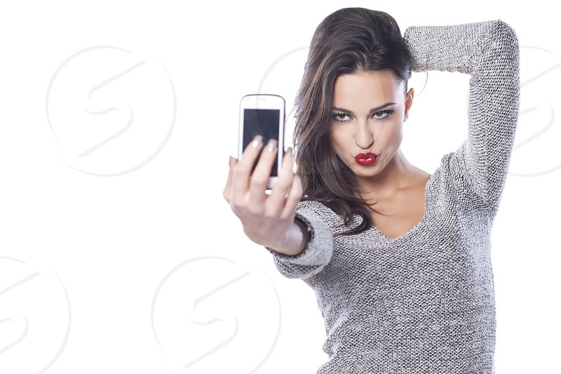 pretty girl make a duck face and take a self portrait photo