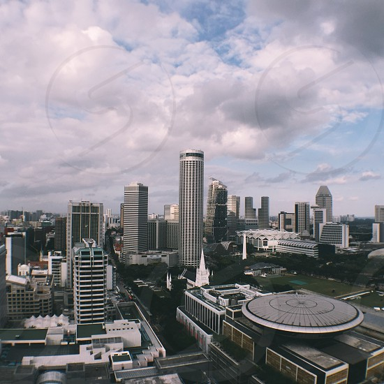 medium and high rise buildings under white clouds and blue sky during daytime photo