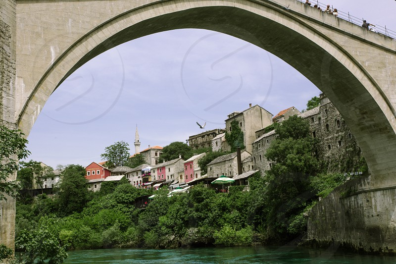 photography of gray concrete bridge above a river photo