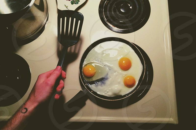 sunny side up eggs on pan photo