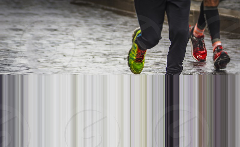marathon race on a rainy day. Detail on running shoes. photo