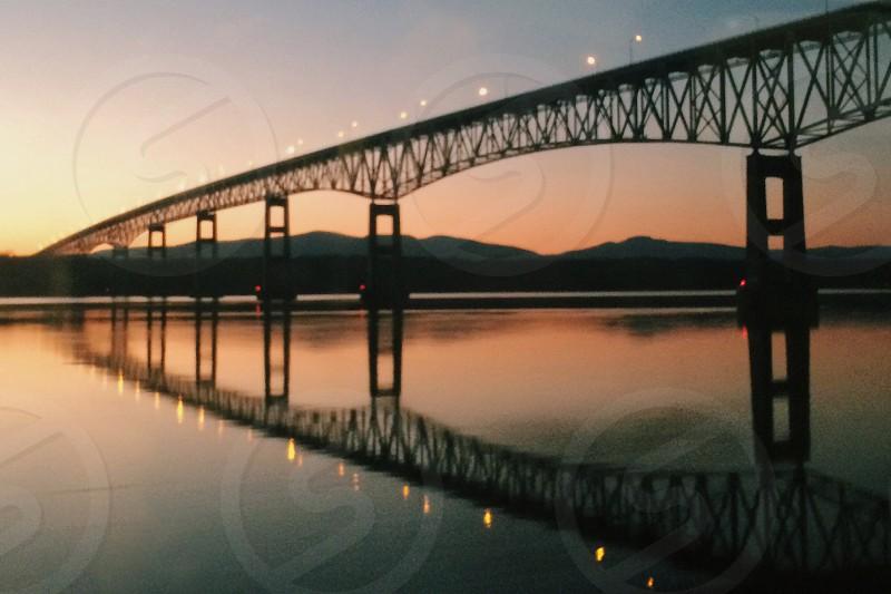 Sunset and bridge on the Hudson River  photo
