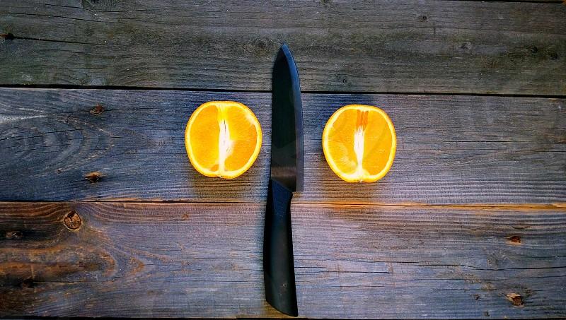 orange sectional vitamin fruit knife photo