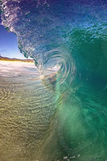 Wave surf surfing tube sandbar shallow water Oahu north shore Hawaii  photo