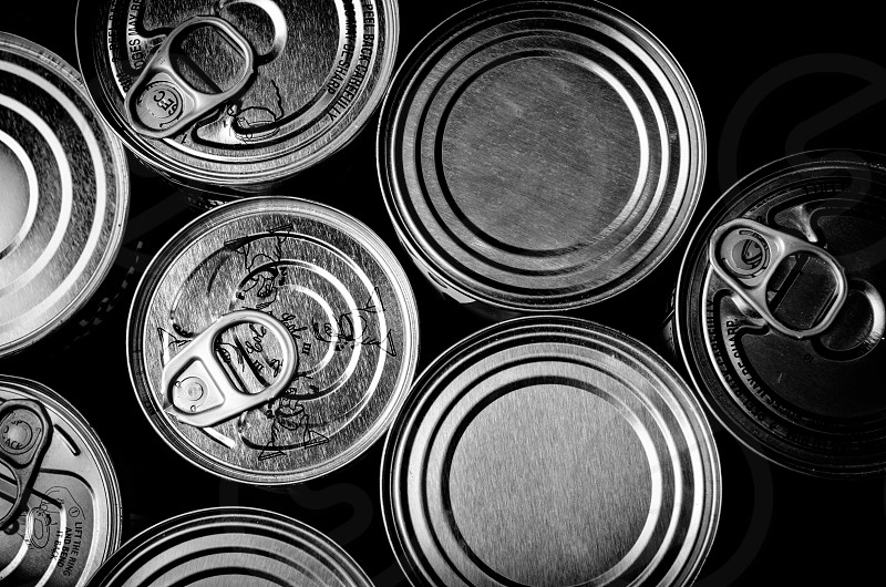 cans hunger hungry feast masculine consumerism change black and white hungry feed satiating photo