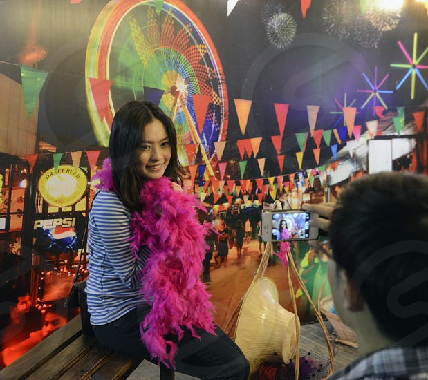 a women at a nightmarket at the Santichaiprakan Park at the Mae Nam Chao Phraya River in the city of Bangkok in Thailand in Southeastasia. photo