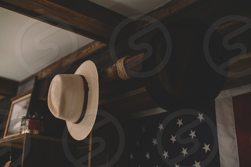 black and white hats on wall with american flag photo