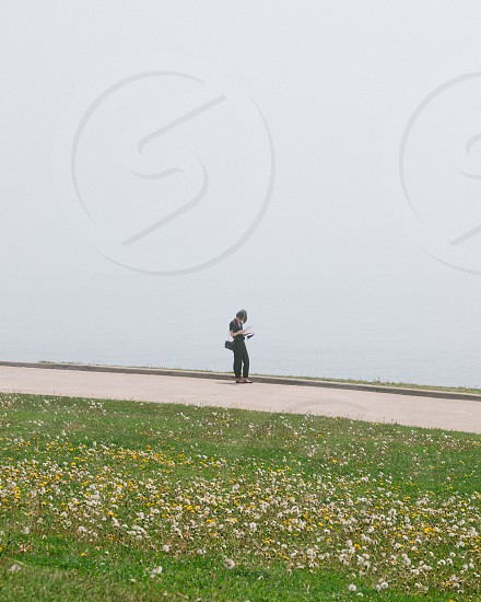 woman reading map by the lake. photo