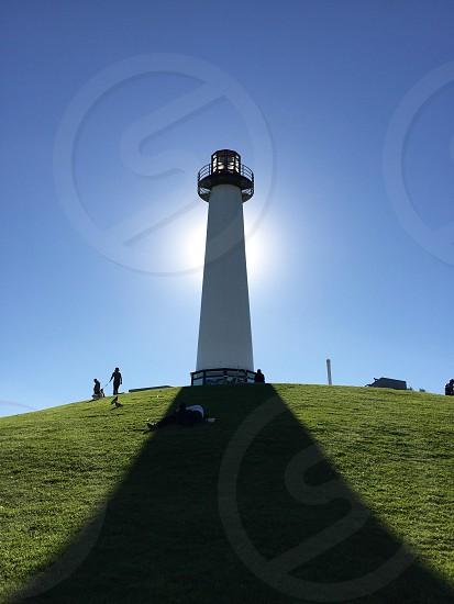 white lighthouse covering sunlight photo