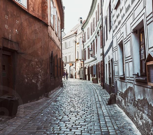 Narrow cobbled street in Cesky Krumlov old town UNESCO site photo