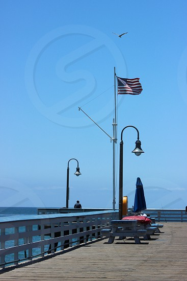 grey and blue picnic table near USA flag photo