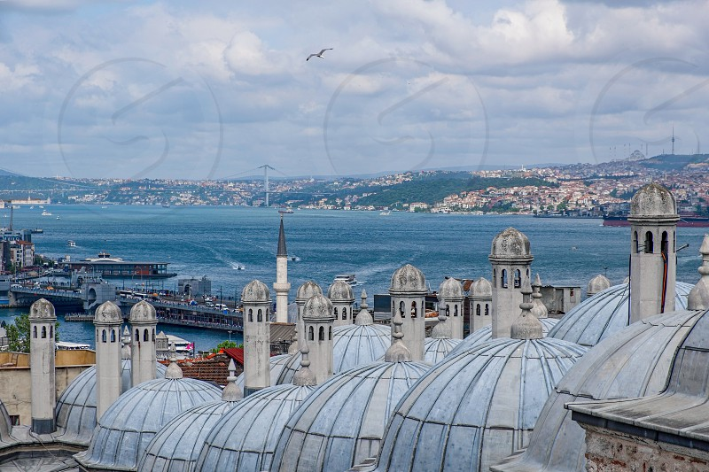 ISTANBUL TURKEY - MAY 28 : View across the rooftops of the Suleymaniye Mosque in Istanbul Turkey on May 28 2018 photo