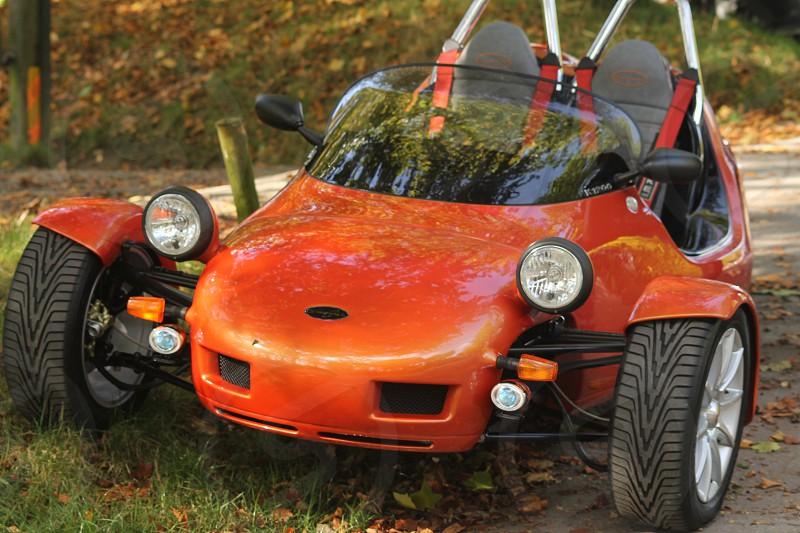 Motorbike custom made bike enthusiasts meeting. orange shiny  spectacular tyres  original photo