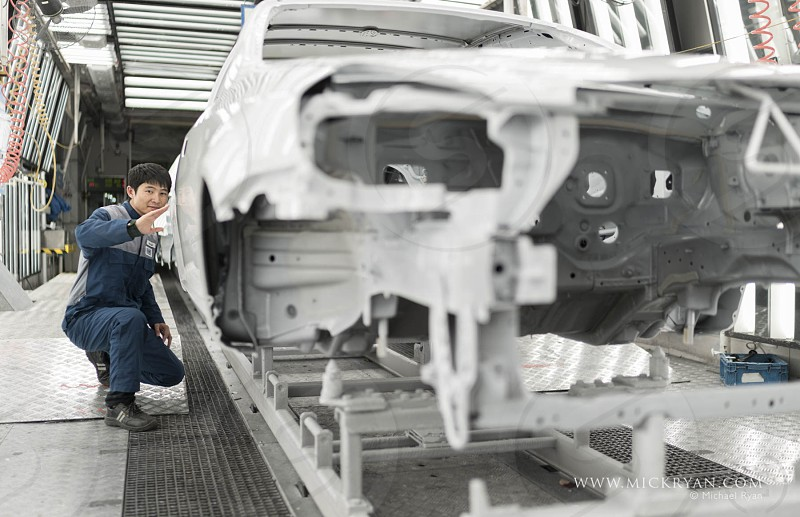 Skilled factory workers in China in high tech facilities. photo