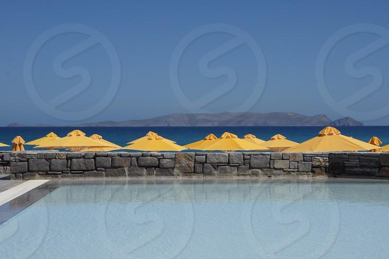 Yellow parasols at a tropical beach resort. photo