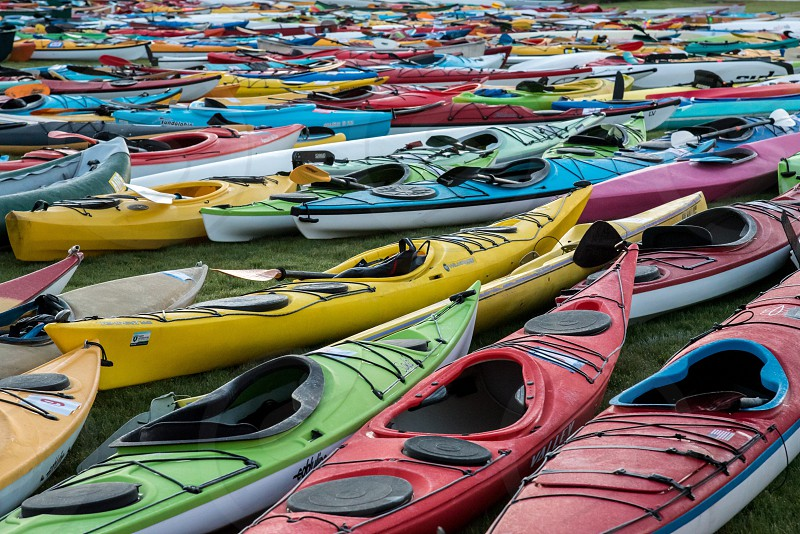 Boats kayak many sport outdoors lined up water recreation colors photo