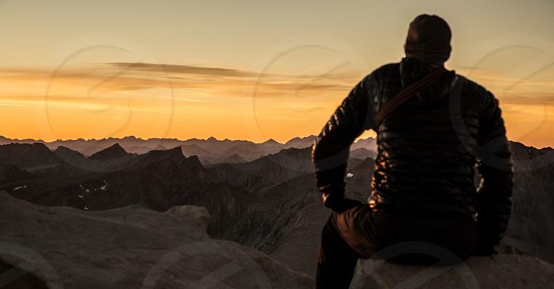 man sitting wearing a black jacket photo
