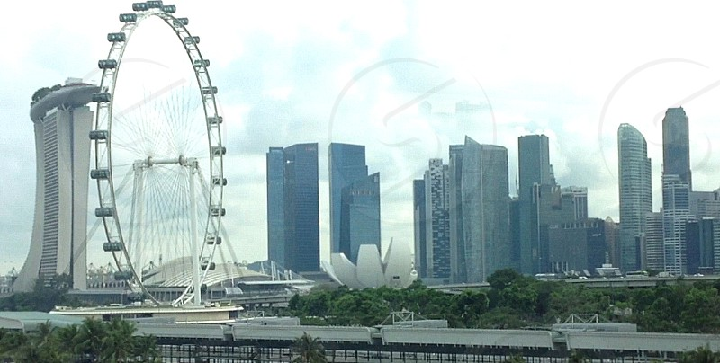 Panoramic view of Singapore showcasing the lovely architecture and the Singapore flyer. photo