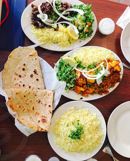 food dinner family Indian desi meal together rice curry naan ethnic culture immigrant photo