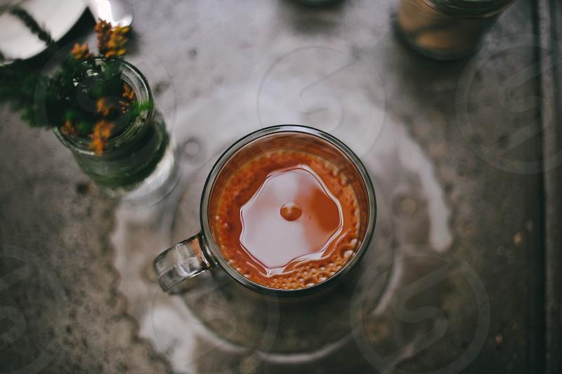 brown liquid in clear glass mug photo