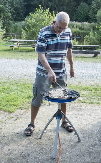 man coocking food with gas comfort on the camping photo