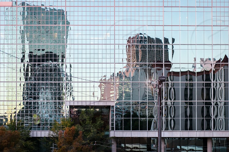 Atlanta GA buildings reflected in high rise. Reflection skyline trees glass windows ferris wheel.  photo
