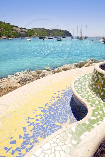 Andratx port view from colorful tiles mosaic bench seat in Mallorca photo