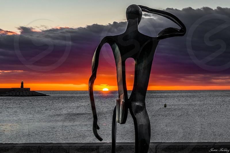 Costa blanca javea sunrise port lighthouse dawn Spain sea ocean sculpture  photo