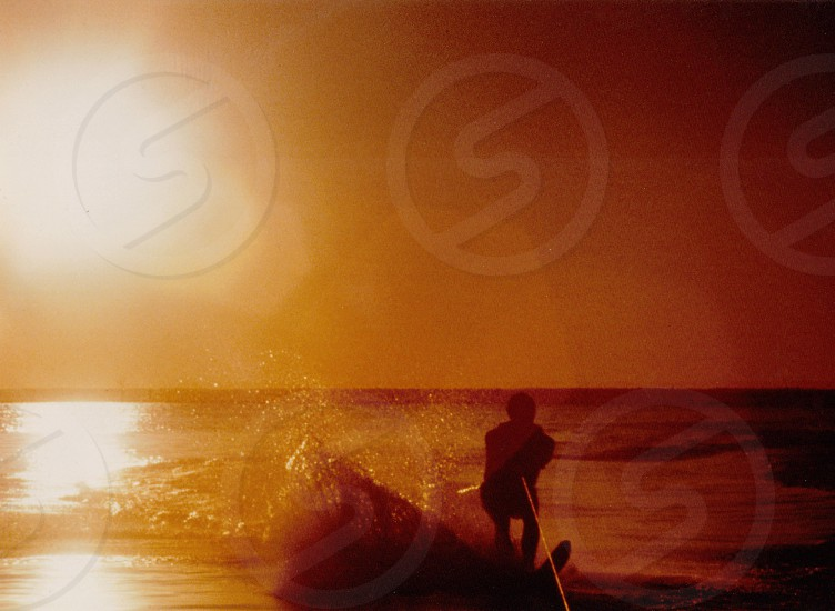 human with surfing board silhouette  photo