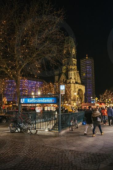 group of people on KurFurstendamm during night time photo
