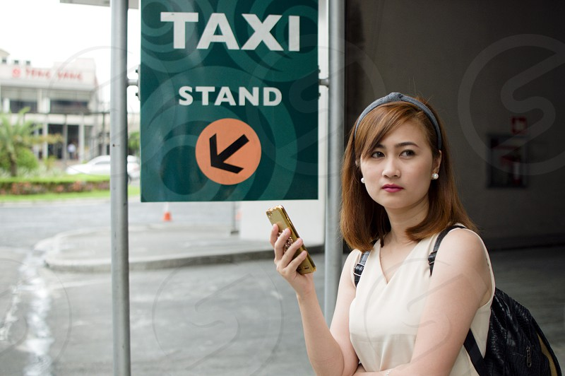 A woman is waiting for a taxi photo